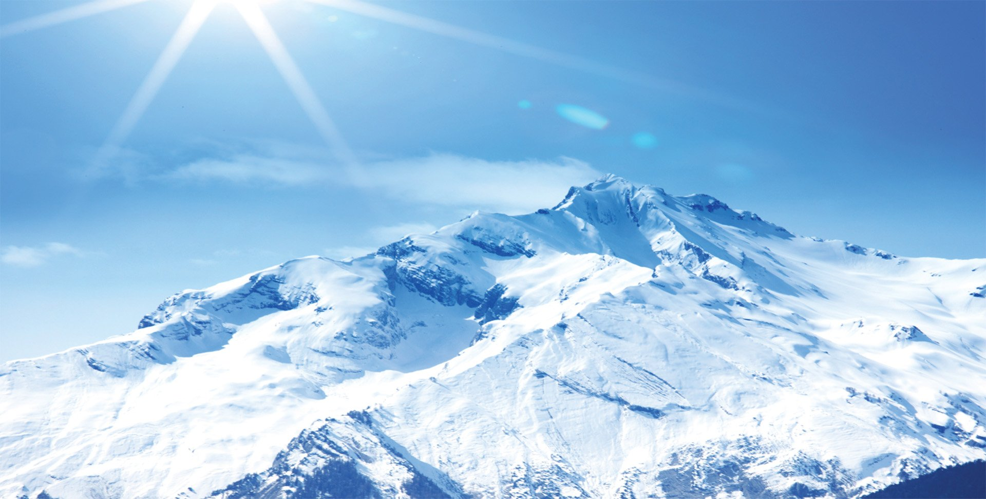 mountain peak with snow and sunlight
