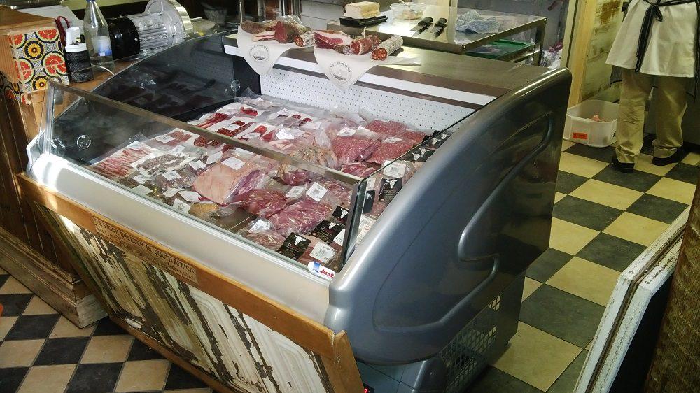 Meat fridge with meat in it