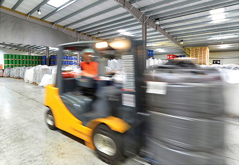 forklift truck carrying goods